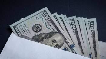 Рубль в начале торгов символически снижается к доллару